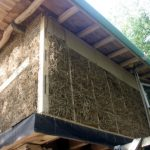 straw wall and round pole